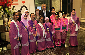 [ image ] Posing for a photograph with Japanese ambassador Miyagawa and his wife