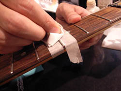 Apply masking tape prior to polishing a fret