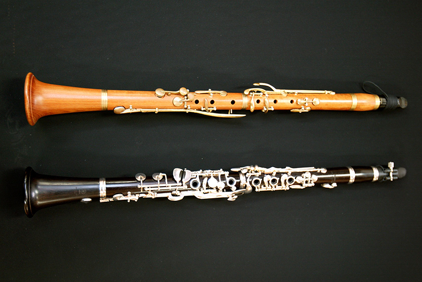 An old-time boxwood clarinet (top) and a modern-day grenadilla clarinet (bottom)