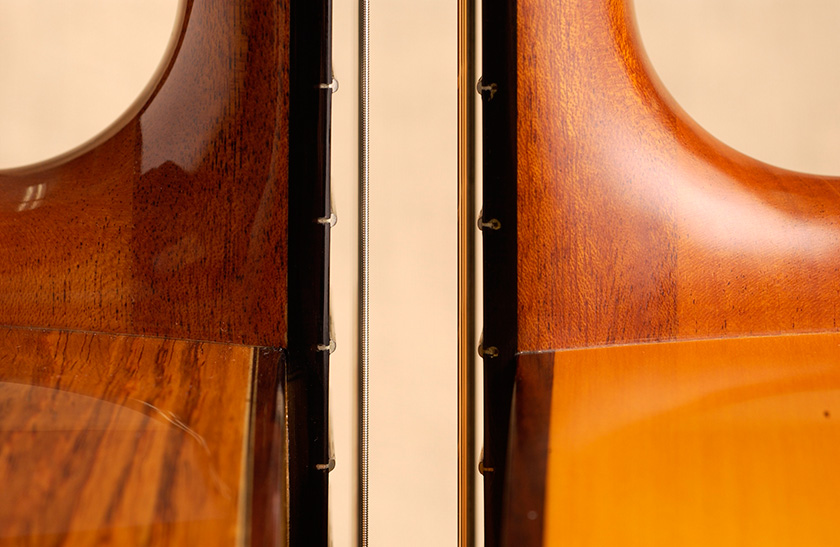 The strings are positioned higher on a classical guitar (left) than a flamenco guitar (right)
