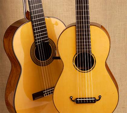 A modern guitar, left, and a nineteenth century guitar, right.
