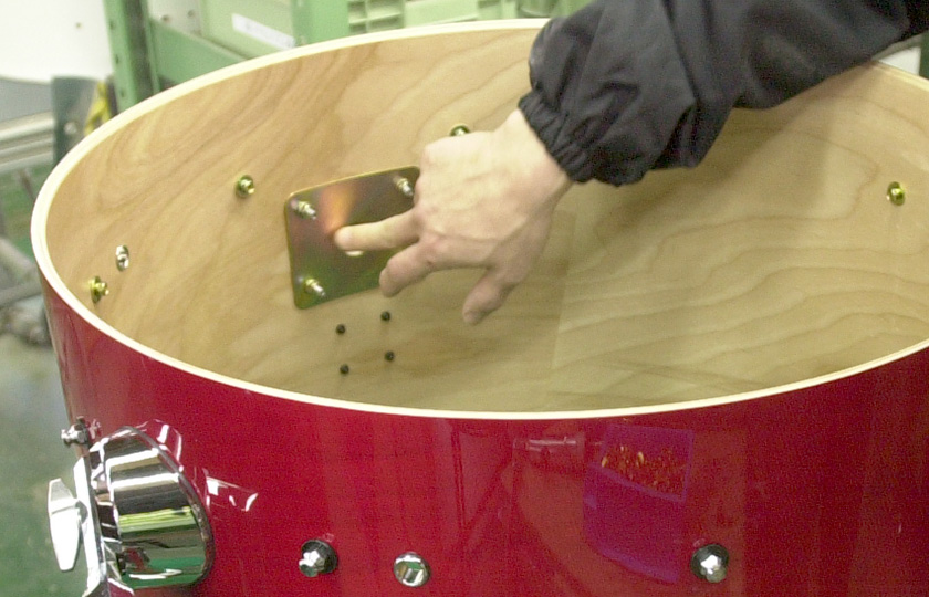 Attaching hardware to a bass drum