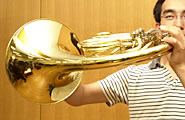 A horn player performing with his bell up.