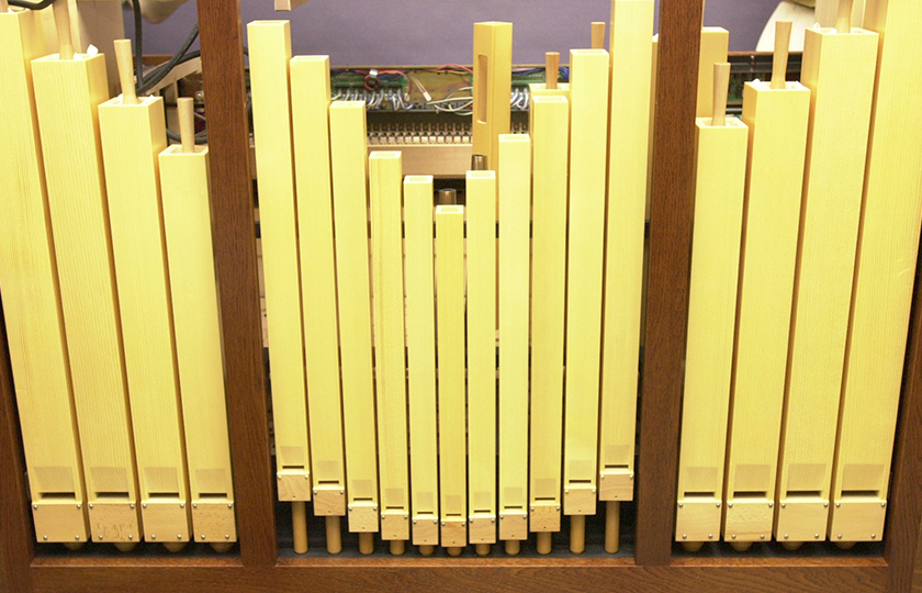 Wooden cuboid pipes arranged so as to appear bilaterally symmetrical.