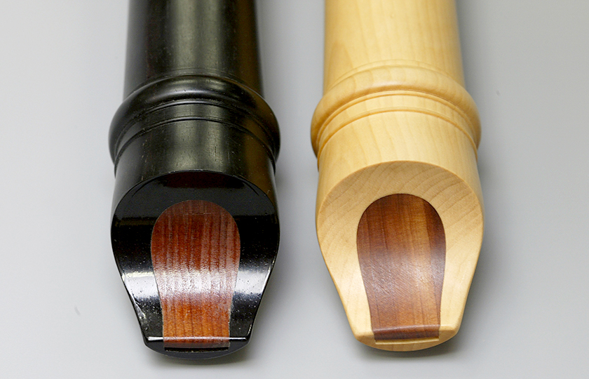 Recorders made from ebony, left, and Japanese boxwood (Buxus microphylla var. japonica), right. The blocks in both recorders are made from red cedar