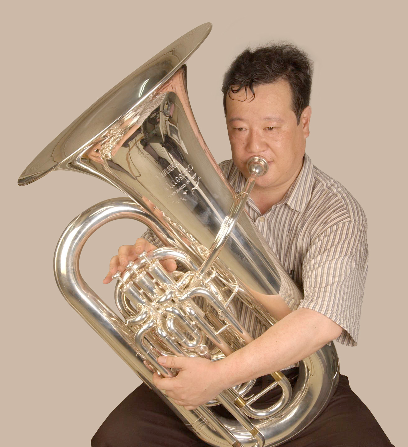 Top-action tubas have the bell on the player's right side
