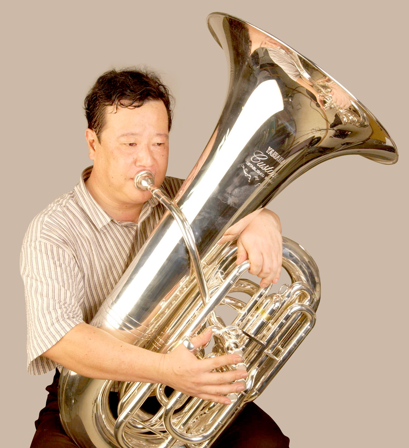 Front-action tubas have the bell on the player's left side