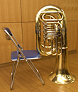 Use a chair to support the tuba