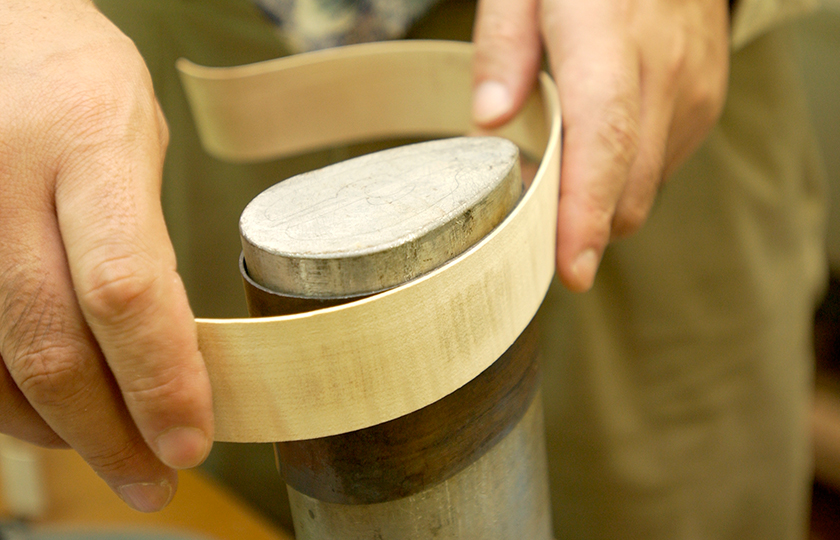 Pre-bending a side plate with an iron