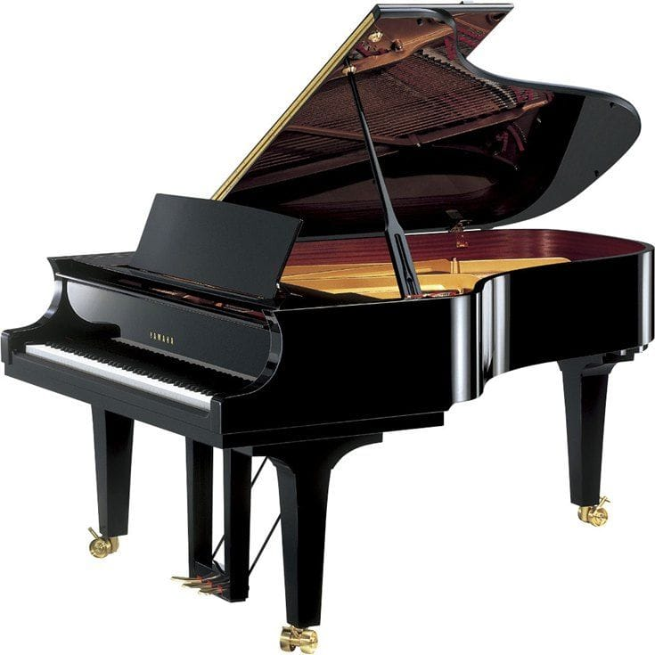 Yamaha grand piano with lid open viewed from right side.