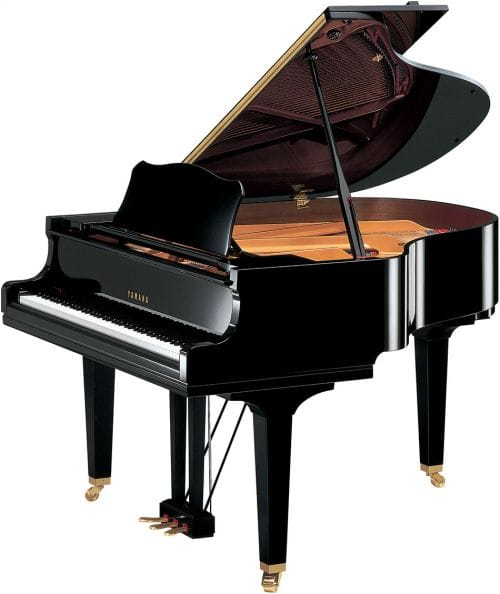 Image of small Yamaha baby grand piano with lid open viewed from right side.