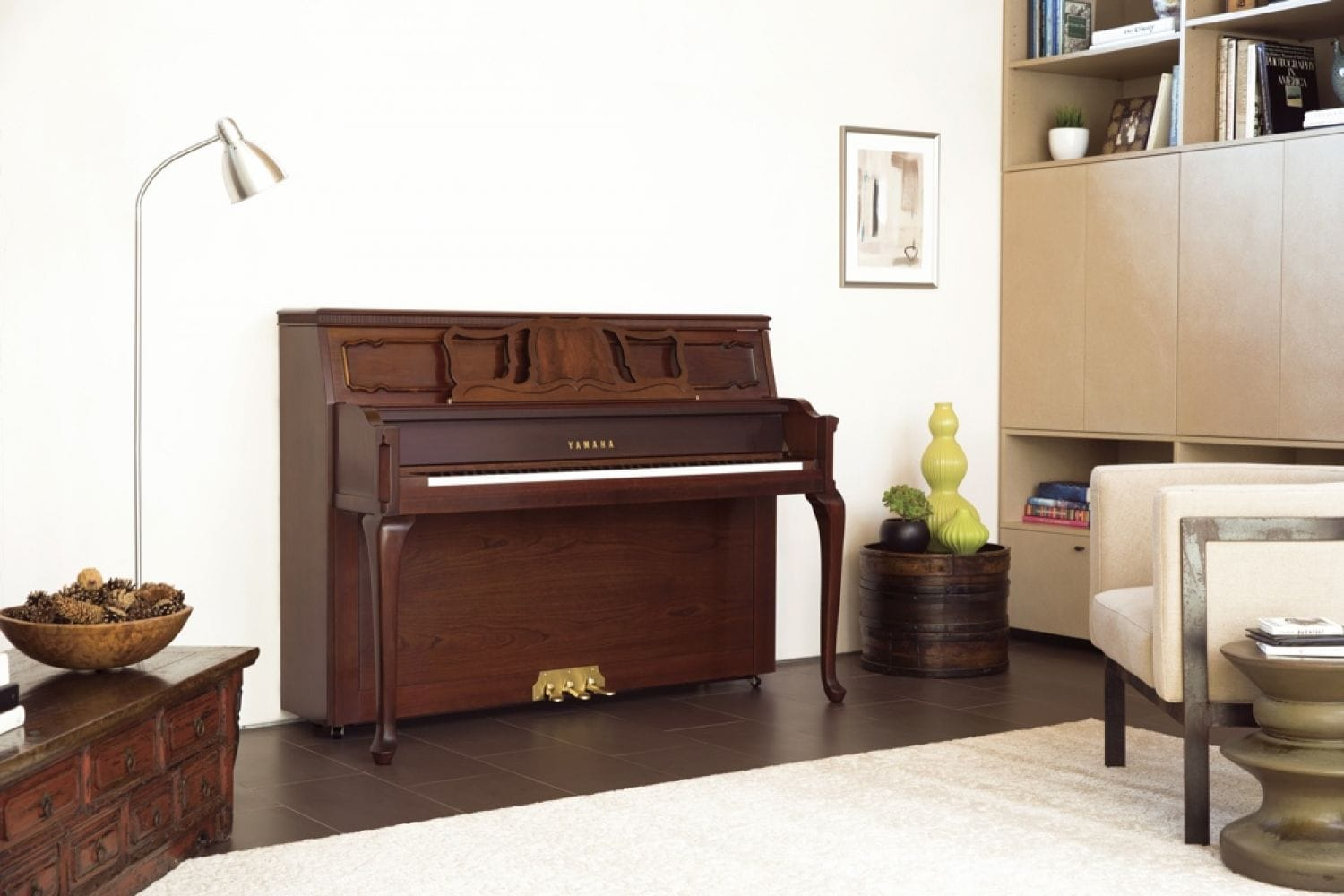 A Yamaha upright with a traditional feel with Queen Anne legs in an eclectically designed living space.