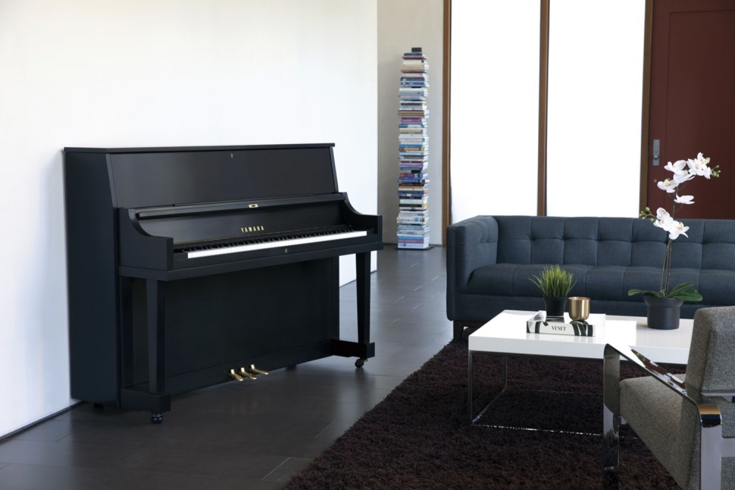 A Yamaha upright piano in a modern living room.