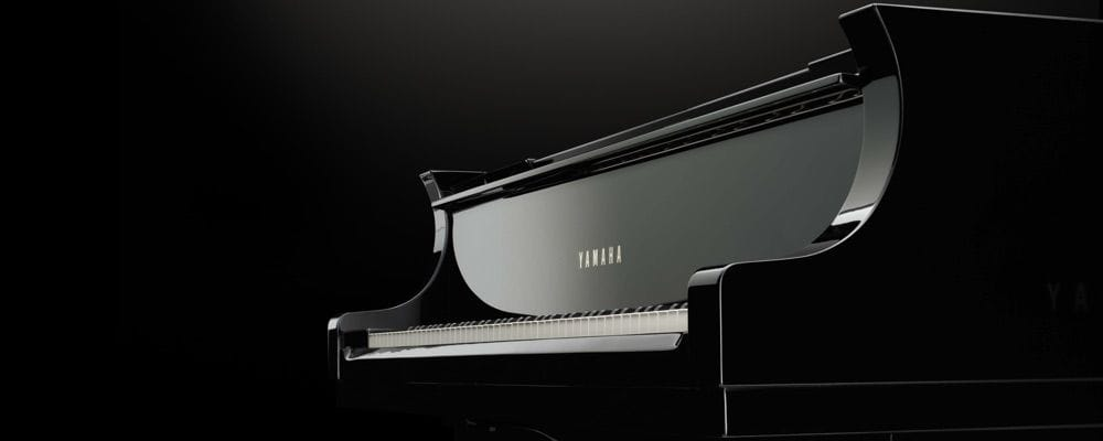 View of a Yamaha grand piano's keyboard.