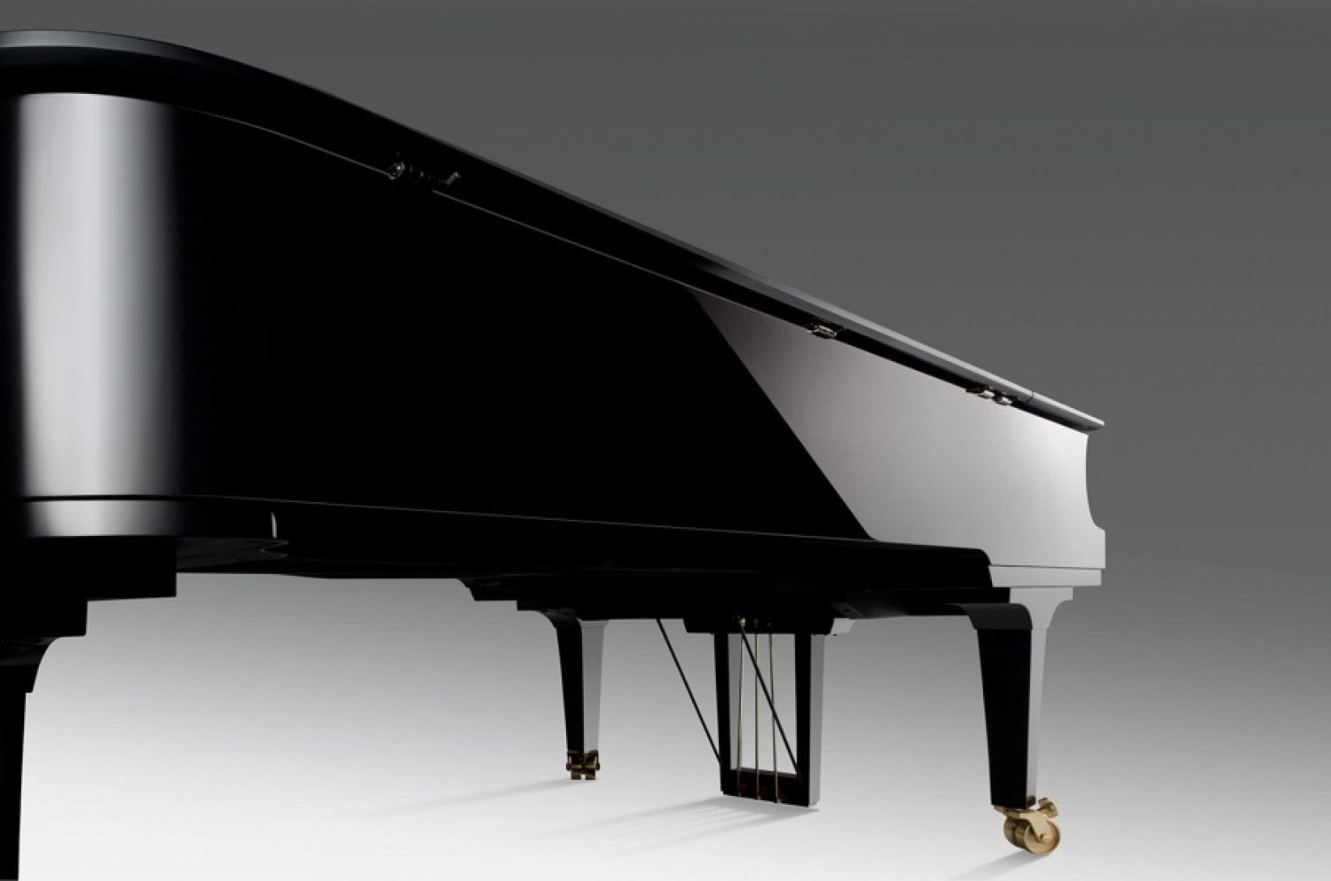 A view of the left side of a piano with a focus on the highly polished finish.