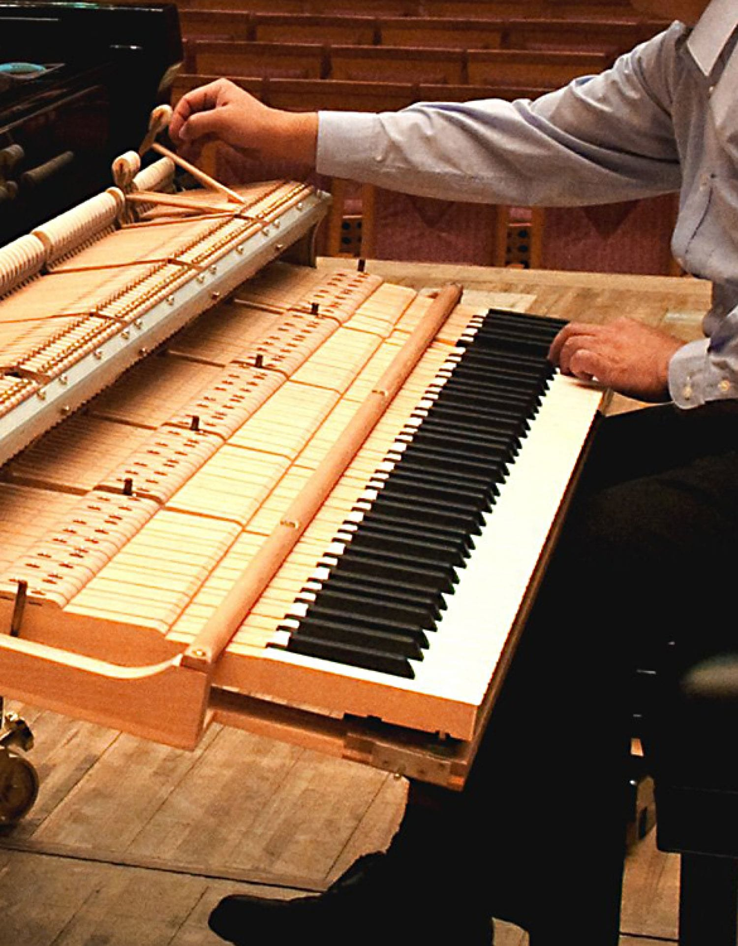 Technician testing hammers as he hits keys.