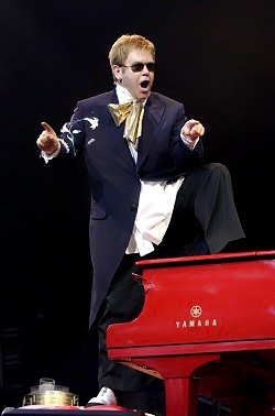 Elton Stands on the Piano