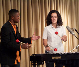 Stefon Harris instructing young woman on the Vibraphone